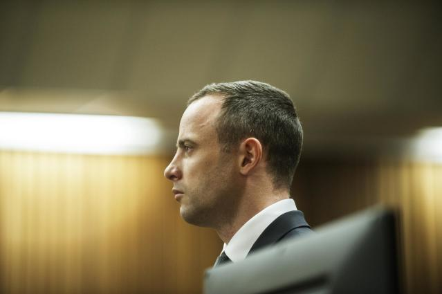 Oscar Pistorius stands in the dock in court in Pretoria, South Africa, Wednesday, May 14, 2014, as the judge overseeing his murder trial ordered him to undergo psychiatric tests. The court adjourned until May 21, 2014. (AP Photo/Gianluigi Guercia - Pool)