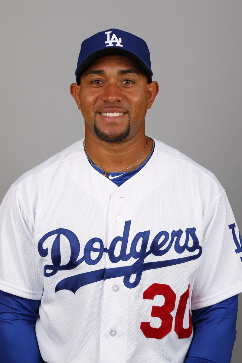 Dodgers release Olivo after minor league brawl