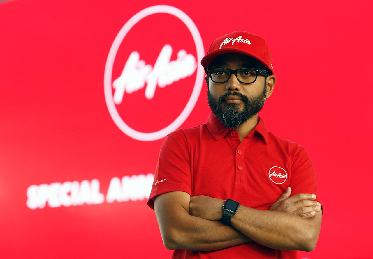 Newly appointed AirAsia CEO of Malaysian Operations Riad Asmat poses for photos after a news conference at AirAsia headquarters in Sepang, Malaysia December 13, 2017. REUTERS/Lai Seng Sin