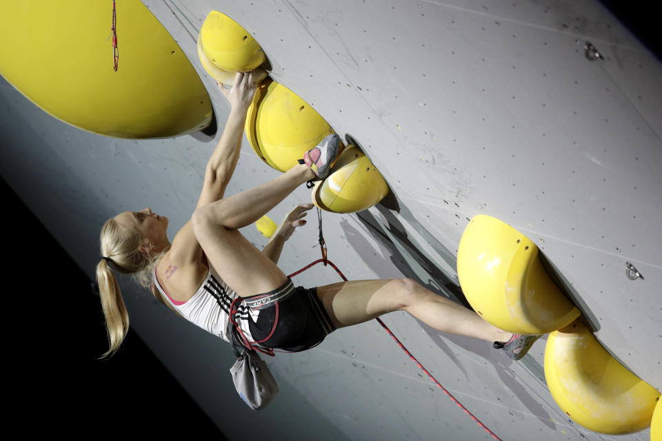 FILE - Janja Garnbret, of Slovenia, competes in the women's combined lead final at the International Federation of Sport Climbing World Championships in Tokyo, in this Aug. 20, 2019, file photo Climbing has always been a niche sport among outdoor enthusiasts. Inclusion in the 2021 Tokyo Olympics will take it mainstream and the world will see just how difficult it is clinging to tiny hand holds with fingers and toes. (AP Photo/Jae C. Hong, File)