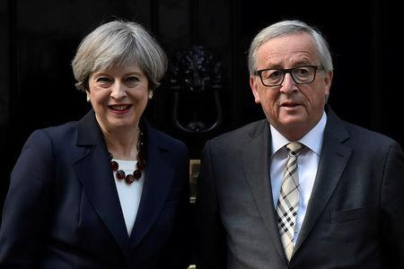 Britain's Prime Minister Theresa May welcomes Head of the European Commission, President Juncker to Downing Street in London