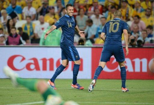 French midfielder Jeremy Menez (L) celebrates with teammate Karim Benzema after scoring during their Euro 2012 Group D match against Ukraine, on June 15, at the Donbass Arena in Donetsk. France won 2-0