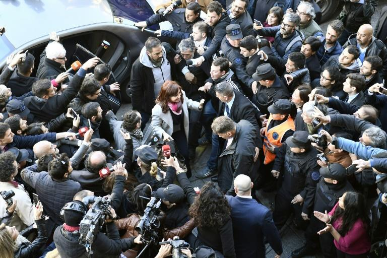 Handout picture released by the Argentine Senate press office showing former Argentine president Cristina Kirchner (C) arriving at the Senate in Buenos Aires on August 22, 2018