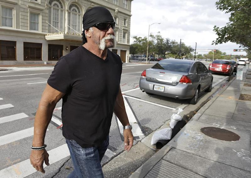 "Reality TV star and former pro wrestler Hulk Hogan, whose real name is Terry Bollea, arrives at the United States Courthouse for a news conference Monday, Oct. 15, 2012 Tampa, Fla. Hogan says he was secretly taped six years ago having sex with the ex-wife of DJ Bubba ""The Love Sponge"" Clem. Portions of the video of Hogan and Heather Clem were posted on the online gossip site Gawker. (AP Photo/Chris O'Meara)"