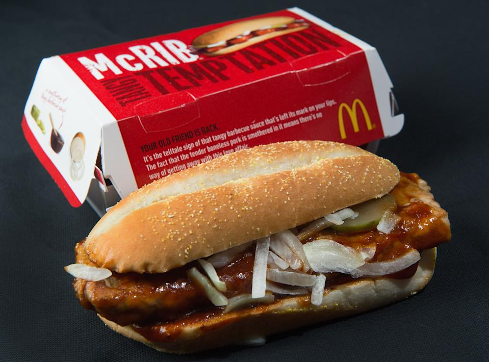 TO GO WITH AFP STORY US-FOOD-SOCIETY-MCDONALD'S A photo of a McDonalds' McRib sandwich, November 2, 2010. Fast food giant McDonald's is bringing back a sandwich -- the McRib -- that gained cult acclaim over the last three decades, in a move lauded by fans known to travel great distances in the hunt for the coveted treat.The boneless pork chop between a bun and slathered with tangy BBQ sauce, topped with onions and pickles, was first launched in 1981, and with rare exceptions has only been offered for sale in select McDonald's for a few weeks at a time. From Tuesday, it will be available nationwide, and for an entire month. AFP Photo/Paul J. Richards (Photo credit should read PAUL J. RICHARDS/AFP/Getty Images)