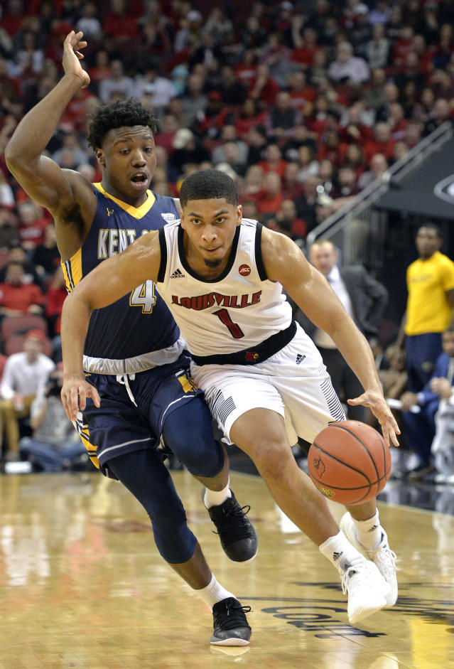 Louisville guard Christen Cunningham (1) drives around the defense of Kent State guard Antonio Williams (4) during the second half of an NCAA college basketball game in Louisville, Ky., Saturday, Dec. 15, 2018. Louisville won 83-70. (AP Photo/Timothy D. Easley)