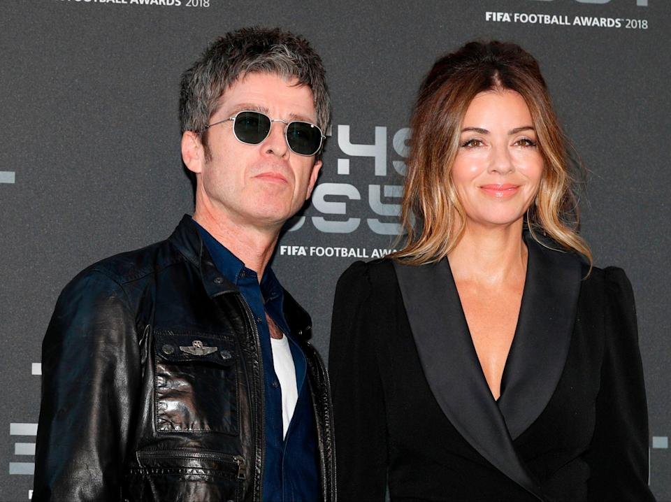Noel Gallagher with his wife, Sarah MacDonald (AFP via Getty Images)