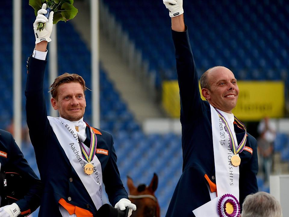 The Dutch equestrian team standing on a podium with medals