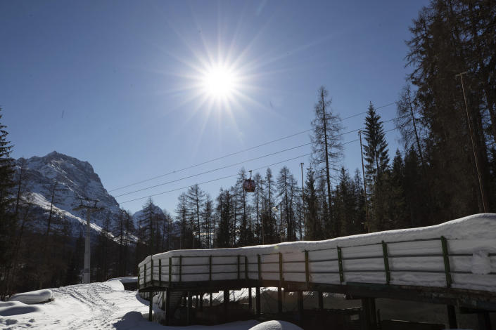 "A view of the bobsled track in Cortina d'Ampezzo, Italy, Wednesday, Feb. 17, 2021. The Cortina track was built in 1923 and the resort known as the ""Queen"" of the Italian Dolomites was home to bobsledding great Eugenio Monti, who won six Olympic medals between 1956 and 1968. (AP Photo/Gabriele Facciotti)"