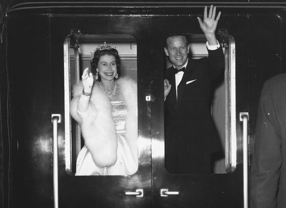 <p>The Queen and Prince Philip wave as they leave Liverpool after attending an ice show Snow White And The Seven Dwarfs in 1961.</p>