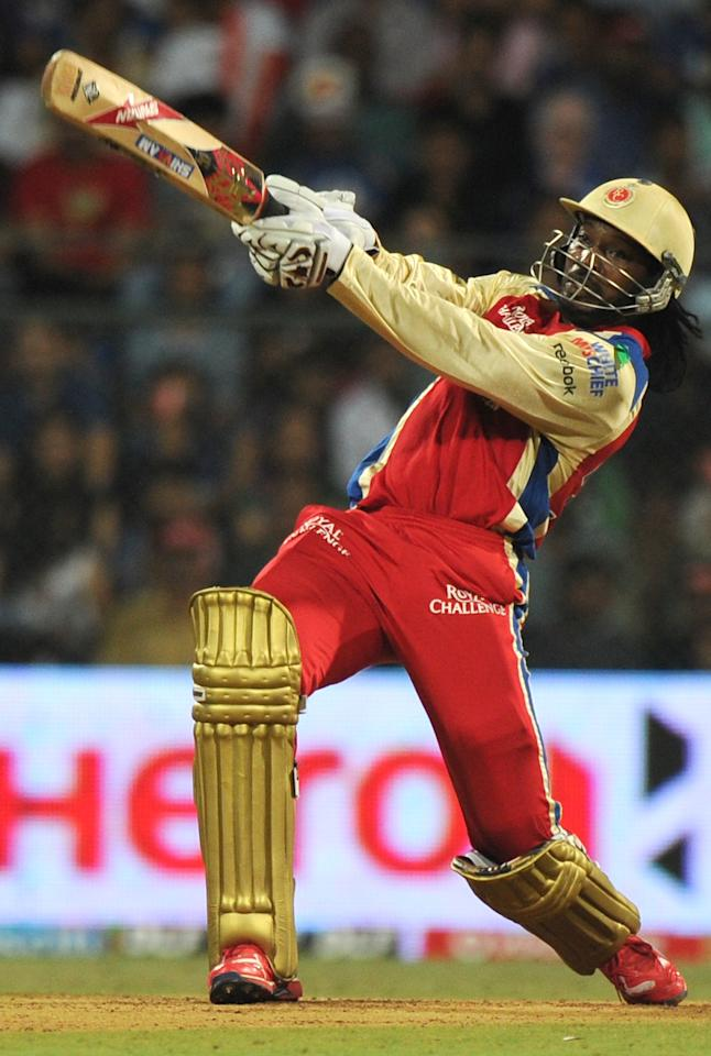 Royal Challengers Bangalore batsman Chris Gayle plays a shot during the IPL Twenty20 cricket match between Mumbai Indians and Royal Challengers Bangalore at The Wankhede Stadium in Mumbai on May 9, 2012.  RESTRICTED TO EDITORIAL USE. MOBILE USE WITHIN NEWS PACKAGE    AFP PHOTO/Indranil MUKHERJEE        (Photo credit should read INDRANIL MUKHERJEE/AFP/GettyImages)