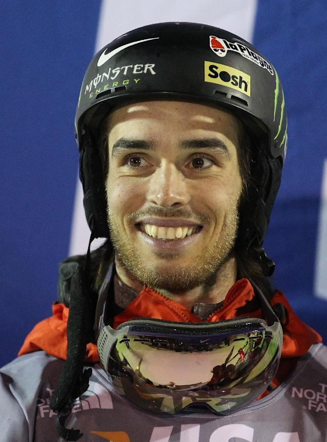 First-place finisher Kevin Rolland, of France, celebrates on the podium following the men's U.S. Grand Prix freestyle halfpipe skiing event on Friday, Jan. 17, 2014, in Park City, Utah. (AP Photo/Rick Bowmer)