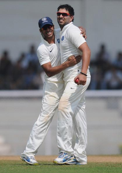 MUMBAI, INDIA - OCTOBER 31:  Yuvraj Singh of India 'A' celebrates capturing the wicket of Kevin Pietersen of England with Manoj Tiwary (L) during the second day of the opening tour match between India 'A' and England at the CCI (Cricket Club of India) ground on October 31, 2012 in Mumbai, India.  (Photo by Pal Pillai/Getty Images)