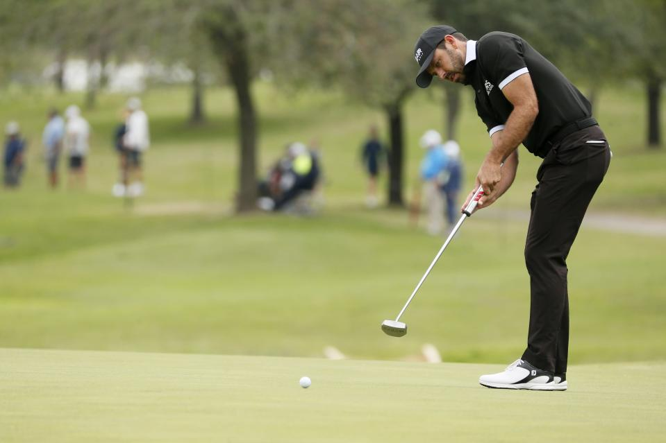 Charl Schwartzel, of South Africa, putts on the first green during the final round of the AT&T Byron Nelson golf tournament in McKinney, Texas, Sunday, May 16, 2021. (AP Photo/Ray Carlin)