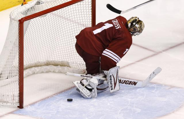 Phoenix Coyotes' Thomas Greiss, of Germany, gives up a goal to Sabres' Zemgus Girgensons during the third period of an NHL hockey game Thursday, Jan. 30, 2014, in Glendale, Ariz. The Sabres defeated the Coyotes 3-2. (AP Photo)