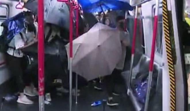 Chaos on Hong Kong's MTR network as police chase protesters