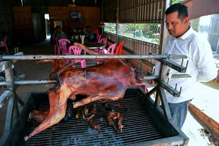 An estimated two to three million dogs are slaughtered annually in Cambodia, according to the NGO Four Paws, which identified more than 100 dog meats restaurants in the capital Phnom Penh and about 20 in the temple town of Siem Reap (AFP Photo/TANG CHHIN Sothy)