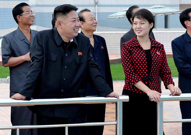 """FILE - In this undated file photo released by the Korean Central News Agency (KCNA) and distributed in Tokyo by the Korea News Service July 26, 2012. North Korean leader Kim Jong Un, front left, accompanied by his wife Ri Sol Ju, front right, inspects the Rungna People's Pleasure Ground in Pyongyang. The online version of China's Communist Party newspaper has hailed a report by The Onion naming Kim as the """"Sexiest Man Alive"""" - not realizing it is satire. The People's Daily on Tuesday, Nov. 27, 2012 ran a 55-page photo spread on its website in a tribute to the round-faced leader, under the headline """"North Korea's top leader named The Onion's Sexiest Man Alive for 2012."""" (AP Photo/Korean Central News Agency via Korea News Service, File)"""