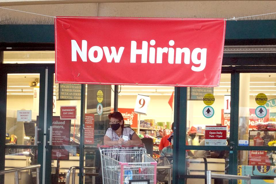 HALLANDALE, FLORIDA - SEPTEMBER 21: A Now Hiring sign hangs near the entrance to a Winn-Dixie Supermarket on September 21, 2021 in Hallandale, Florida. Government reports indicate that Initial jobless benefit claims rose 20,000 to 332,000 in the week ended Sept. 11. (Photo by Joe Raedle/Getty Images)