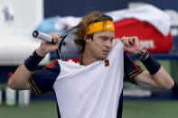 Andrey Rublev, of Russia, wipes sweat from his face during the second round of the US Open tennis championships against Pedro Martinez, of Spain, Wednesday, Sept. 1, 2021, in New York. (AP Photo/John Minchillo)