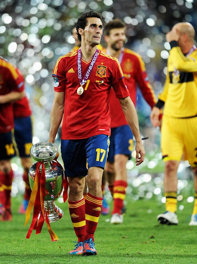 KIEV, UKRAINE - JULY 01: Alvaro Arbeloa of Spain walks across the picth holding the trophy following victory in the UEFA EURO 2012 final match between Spain and Italy at the Olympic Stadium on July 1, 2012 in Kiev, Ukraine. (Photo by Jasper Juinen/Getty Images)