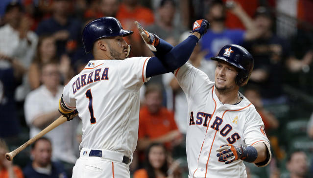 Houston Astros' Carlos Correa (1) celebrates the home run by Alex Bregman, right, against the Los Angeles Angels during the sixth inning of a baseball game, Saturday, Sep. 1, 2018, in Houston. (AP Photo/Michael Wyke)