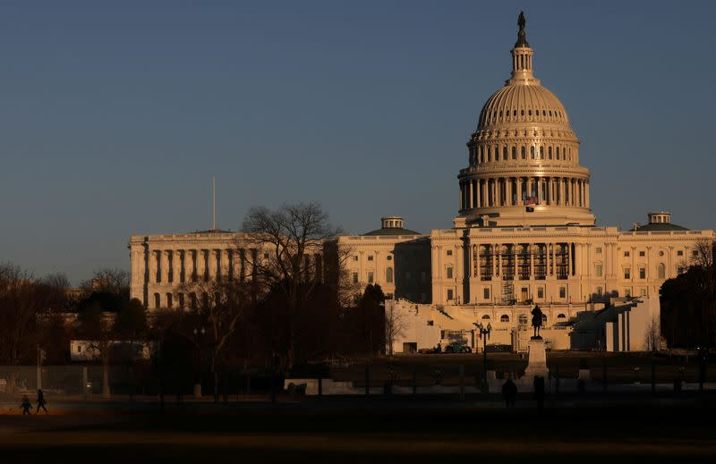 FILE PHOTO: The U.S. Capitol Building is seen behind barbed wire fences in Washington, U.S.