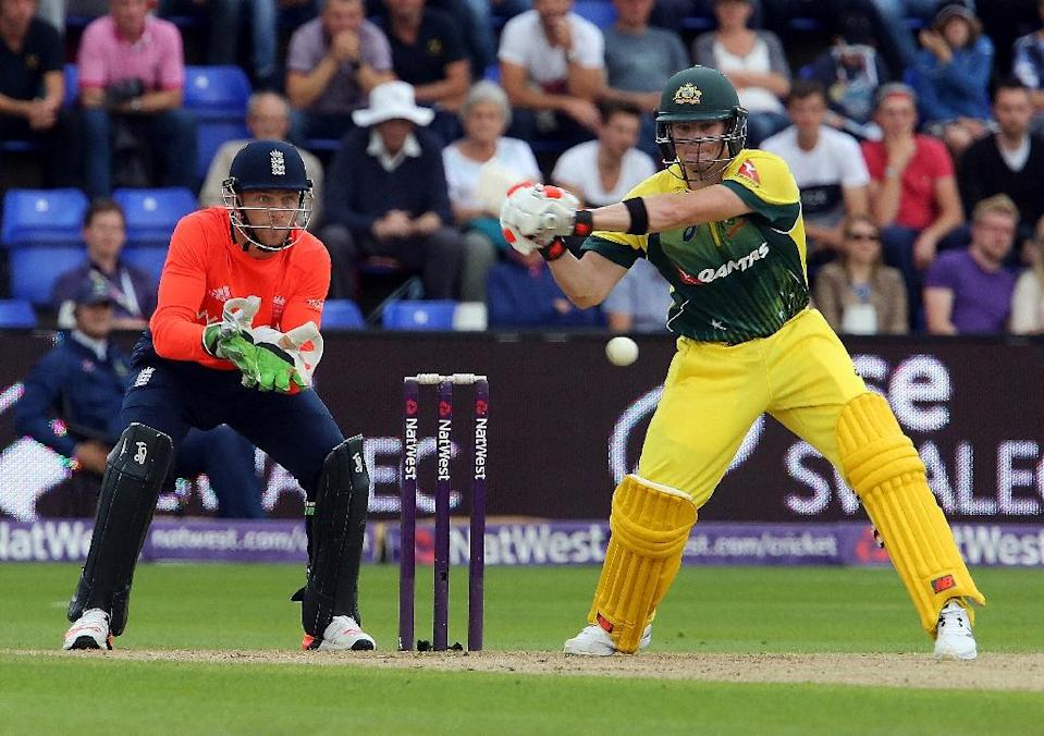 Australia's Steven Smith prepares to play a shot watched by England's Jos Buttler during the Twenty20 International match in Cardiff on August 31, 2015 (AFP Photo/Geoff Caddick)