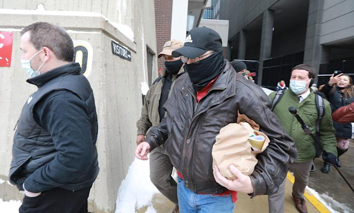 Adam Coy (center, black mask) is released from the Franklin County Jail after posting bond for the killing of Andre Hill, an unarmed black man.