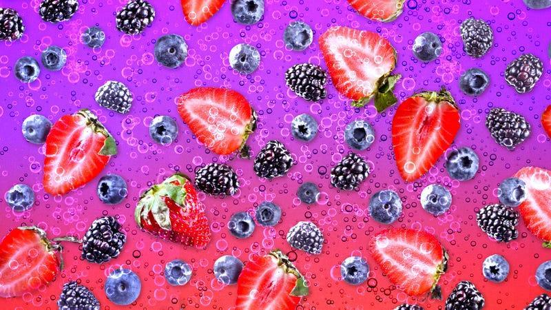 Various berries on a fizzy pink and purple background