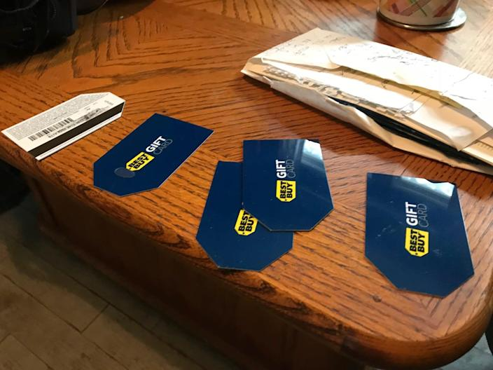 Scammers told Tracy Taschereau to put money on Best Buy gift cards after they deposited fake checks into her account to make it seem like she had money and could qualify for a loan. She read off the numbers on the phone, enabling scammers to have quick access to the cash.