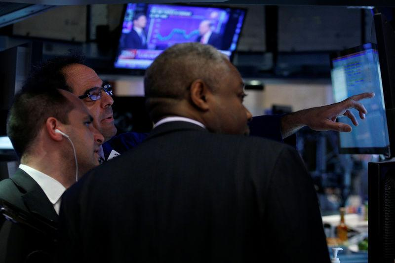 Traders work inside a post on the floor of the NYSE