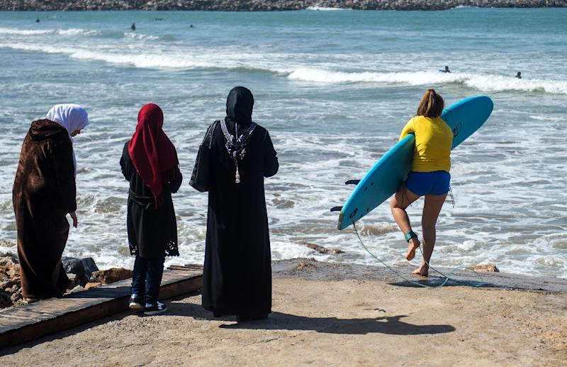 Mentalities differ from beach to beach in Morocco about women surfing, with some more conservative than others (AFP Photo/FADEL SENNA)