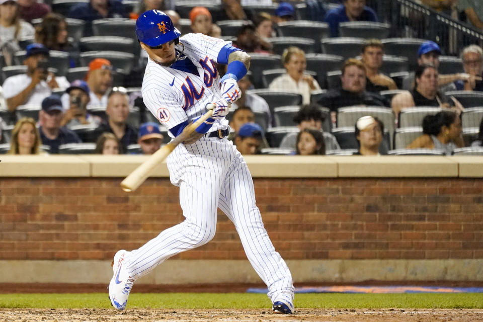 New York Mets' Javier Baez hits a two-run home run in the sixth inning of the baseball game against the Cincinnati Reds, Saturday, July 31, 2021, in New York. (AP Photo/Mary Altaffer)