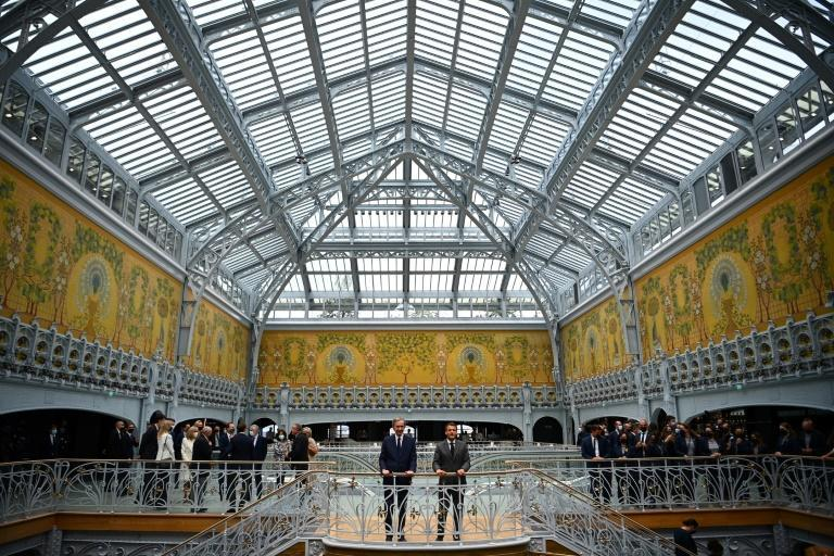 French President Emmanuel Macron attended the opening ceremony alongside the head of French multinational corporation LVMH, Bernard Arnault
