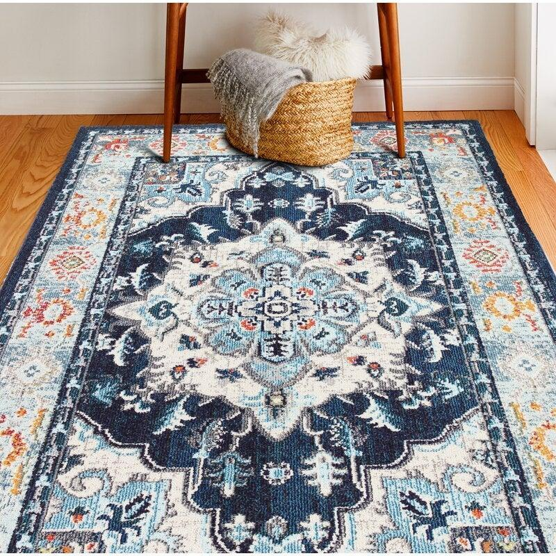 "<h2>Osias Area Rug</h2><br><strong>Discount:</strong> 78% off<br><br><strong>The Hype: </strong>4.8 out of 5 stars and 373 reviews<br><br><strong>Deal Hunters Say: </strong>""This area rug is the 8'6"" X 11'6"". It covers well. The colors are true to advertised photos. It compliments my decor very well. I did not have to worry about the creases or it laying flat. It laid well after placing my furniture on it and sticking a couple of pieces of tape on the ends for a few days. Excellent purchase!""<br><br><em>Shop </em><strong><em><a href=""https://fave.co/2HWojis"" rel=""nofollow noopener"" target=""_blank"" data-ylk=""slk:Mistana"" class=""link rapid-noclick-resp"">Mistana</a></em></strong><br><br><strong>Mistana</strong> Osias Blue/Beige/Orange Area Rug, $, available at <a href=""https://go.skimresources.com/?id=30283X879131&url=https%3A%2F%2Ffave.co%2F2HWojis"" rel=""nofollow noopener"" target=""_blank"" data-ylk=""slk:Wayfair"" class=""link rapid-noclick-resp"">Wayfair</a>"