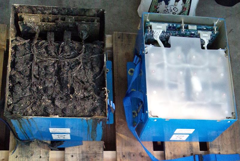 "This Thursday, Jan. 17, 2013 photo provided by the Japan Transport Safety Board shows the distorted main lithium-ion battery, left, and an undamaged auxiliary battery of the All Nippon Airways' Boeing 787 which made an emergency landing on Wednesday, Jan. 16, 2013 at Takamatsu airport in Takamatsu, western Japan. Japanese and U.S. investigators are conducting a probe of the maker of the lithium ion batteries used in Boeing's 787 ""Dreamliner."" Tsutomu Nishijima, a spokesman for GS Yuasa, said Monday, Jan. 21 that the investigators visited the company's headquarters in Kyoto, Japan, and that Yuasa was cooperating with the probe. (AP Photo/Japan Transport Safety Board) EDITORIAL USE ONLY, NO SALES"