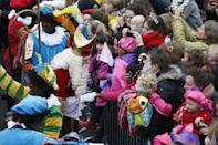 Sinterklaas (Saint Nicolas) and some men dressed as Zwarte Piet (Black Pete) parade in Groningen, Netherlands