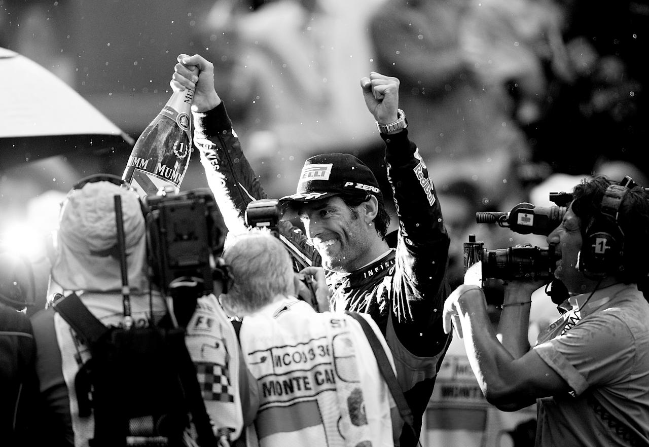 MONTE CARLO, MONACO - MAY 27: (EDITORS NOTE: THIS BLACK AND WHITE IMAGE WAS CONVERTED FROM AN ORIGINAL COLOUR FILE) Mark Webber of Australia and Red Bull Racing celebrates after winning the Monaco Formula One Grand Prix at the Circuit de Monaco on May 27, 2012 in Monte Carlo, Monaco.  (Photo by Vladimir Rys Photography via Getty Images)