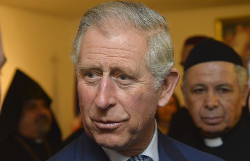 Britain's Prince Charles speaks to religious leaders during a visit to a Syriac Orthodox Church in west London
