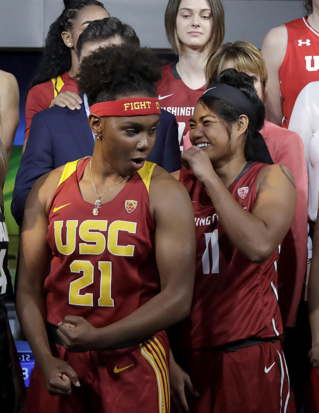 Southern California's Aliyah Mazyck (21) flexes her arm as Washington State's Chanelle Molina laughs during NCAA college basketball Pac-12 women's media day in San Francisco, Wednesday, Oct. 10, 2018. (AP Photo/Jeff Chiu)