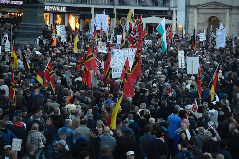 """PEGIDA protestors, """"Patriotic Europeans Against the Islamification of the Occident,"""" hold a protest rally on October 5, 2015 in Dresden, eastern Germany (AFP Photo/Tobias Schwarz)"""