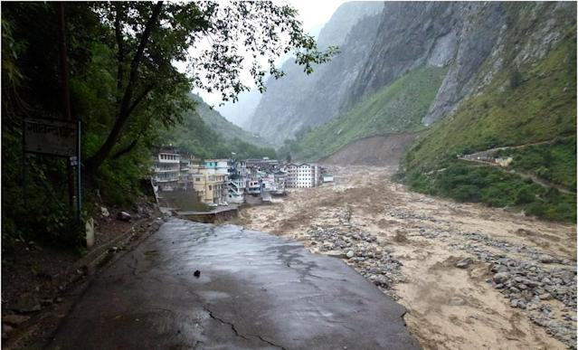 "In this handout photograph released by The Indian Army on June 18, 2013, floodwaters of the River Alaknanda pass by the debris of a shattered roadway in Chamoli district in the northern Indian state of Uttarakhand on June 18, 2013. Torrential rains and flash floods washed away homes and roads in north India, leaving at least feared 60 people dead and thousands stranded, as the annual monsoon hit the country earlier than normal, officials said. Authorities called in military helicopters to try to rescue residents and pilgrims cut off by rising rivers and landslides triggered by more than three days of rain in the Himalayan state of Uttarakhand, officials said. -----EDITORS NOTE---- RESTRICTED TO EDITORIAL USE - MANDATORY CREDIT ""AFP PHOTO / INDIAN ARMY"" - NO MARKETING NO ADVERTISING CAMPAIGNS - DISTRIBUTED AS A SERVICE TO CLIENTS"