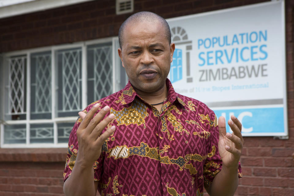 In this Tuesday, April 7, 2020 photo, Abebe Shibru, Zimbabwe's director of Marie Stopes International - a sexual and reproductive healthcare service, gestures, during an interview in Harare. Lockdowns imposed to curb the coronavirus' spread have put millions of women in Africa, Asia and elsewhere out of reach of birth control and other sexual and reproductive health needs. Confined to their homes with husbands and others, they face unwanted pregnancies and little idea of when they can reach the outside world again. (AP Photo/Tsvangirayi Mukwazhi)