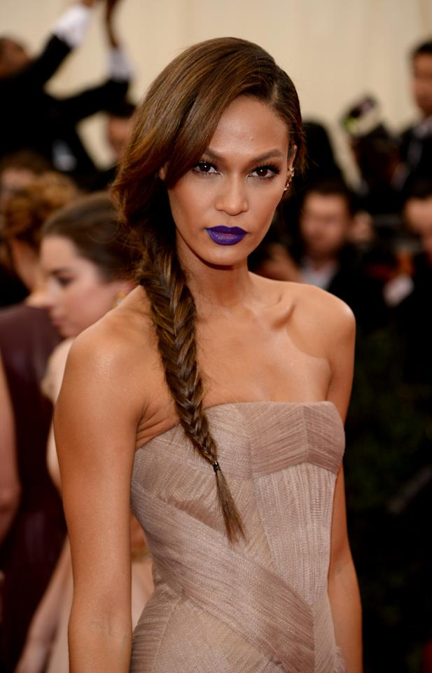 Joan Smalls' Purple Lipstick: Joan Smalls created quite the uproar with her bold lipstick choice in 2014. Arriving at the Met Gala in a beige Vera Wang gown and a shade of purple on her lips, The look has gone down in history as a red carpet beauty dare worth trying.