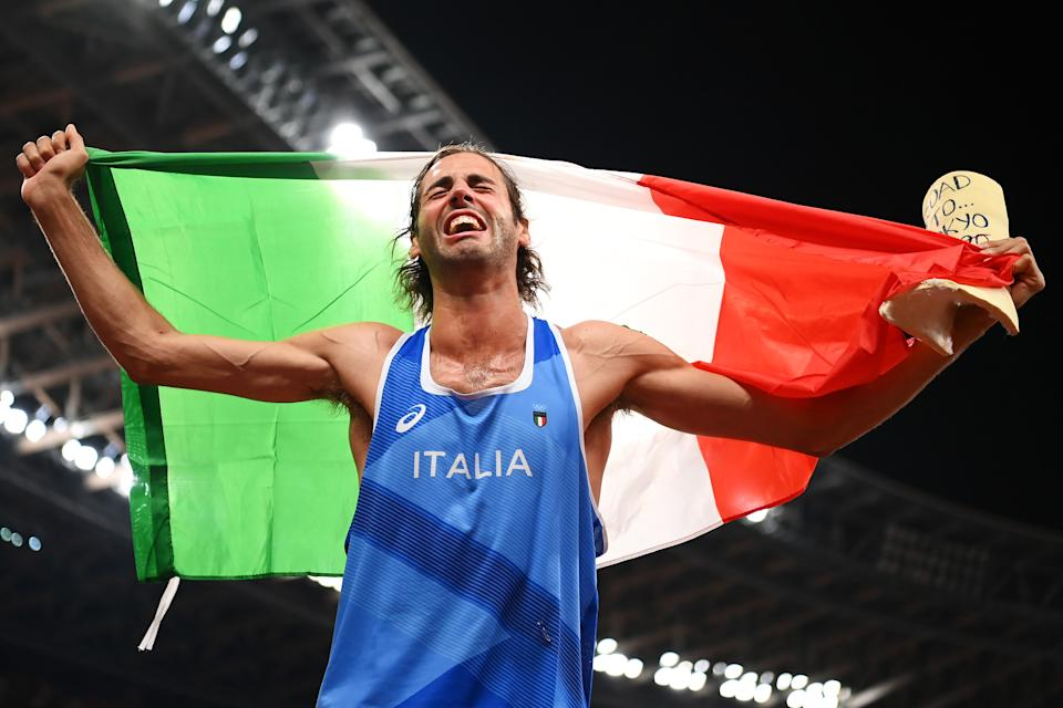 <p>TOKYO, JAPAN - AUGUST 01: Gianmarco Tamberi of Team Italy reacts after winning the gold medal in the men's High Jump on day nine of the Tokyo 2020 Olympic Games at Olympic Stadium on August 01, 2021 in Tokyo, Japan. (Photo by Matthias Hangst/Getty Images)</p>