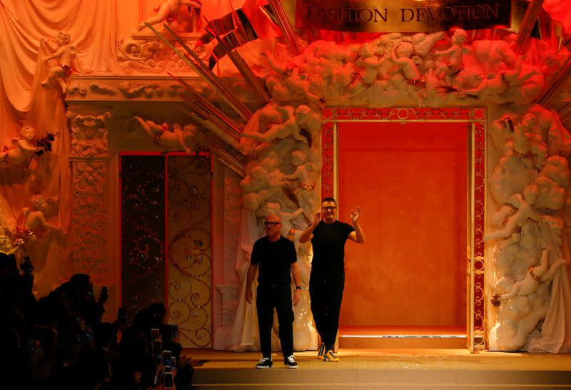 FILE PHOTO:  Italian designers Domenico Dolce and Stefano Gabbana acknowledge the applause at the end of their Autumn/Winter 2018 women's collection during Milan Fashion Week in Milan