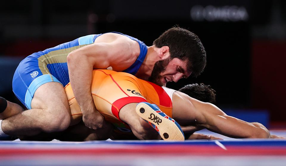CHIBA, JAPAN - AUGUST 5, 2021: Indias Kumar Ravi (R) and ROC's Zaur Uguev fight in the men's freestyle 57kg final wrestling bout at the 2020 Summer Olympic Games, at the Makuhari Messe convention center. Stanislav Krasilnikov/TASS (Photo by Stanislav Krasilnikov\TASS via Getty Images)