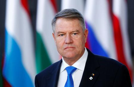 FILE PHOTO: Romanian President Klaus Iohannis arrives at a European Union leaders summit in Brussels, Belgium December 13, 2018. REUTERS/Francois Lenoir/File Photo