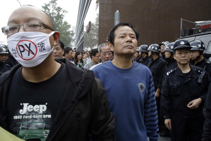 Protesters march towards the city government office in Zhejiang province's Ningbo city, protesting the proposed expansion of a petrochemical factory Sunday, Oct. 28, 2012. Thousands of people in the eastern Chinese city clashed with police Saturday while protesting the proposed expansion of the factory that they say would spew pollution and damage public health, townspeople said. (AP Photo/Ng Han Guan)